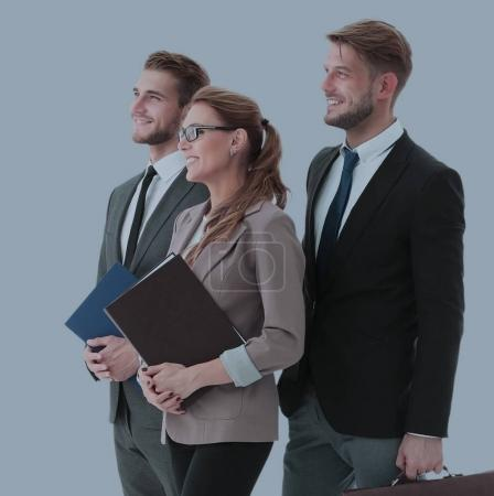 Team of successful and confident people posing on a gray backgro