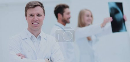 Healthcare, medical and radiology concept - doctors looking at x