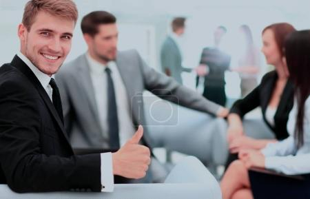 Photo for Group of business partners discussing ideas with their leader on foreground - Royalty Free Image