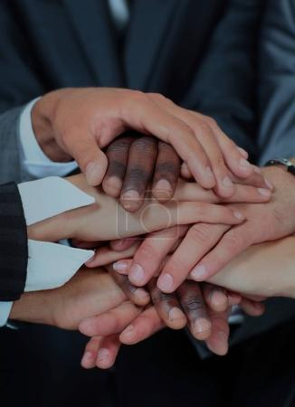 Photo for Team work concept. Business people joining hands. - Royalty Free Image