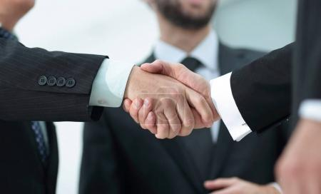 closeup handshake proven business partners