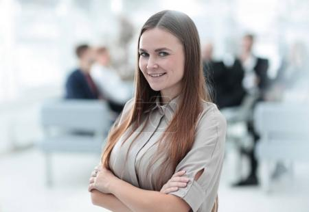 portrait of smiling business woman on the background of the office.