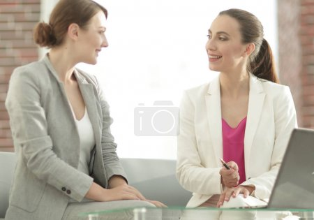 two business women discussing project cooperation