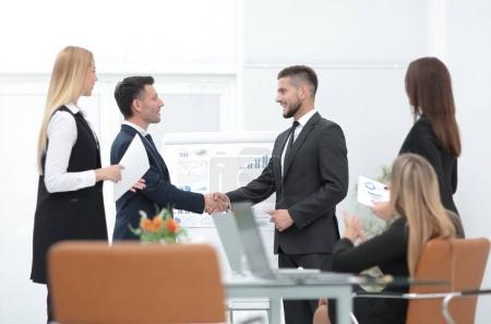 handshake business partners before a business presentation.