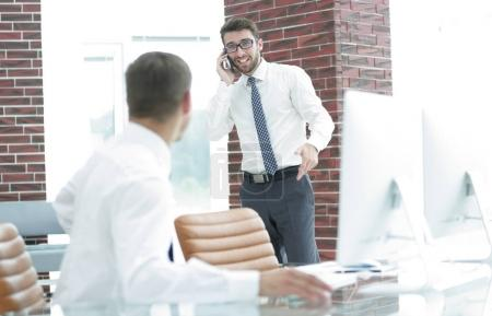 businessman with smartphone on blurred background office