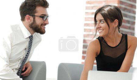 Man and woman are at the table in office.