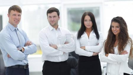 Photo for Successful business team standing in office - Royalty Free Image