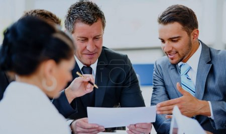 Photo for Image of business partners discussing documents and ideas at meeting - Royalty Free Image
