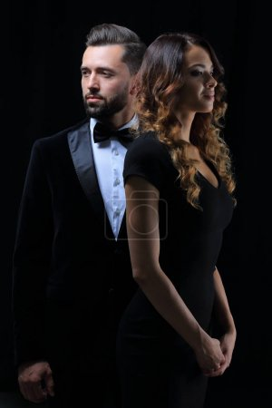 photo of young family couple on black background.