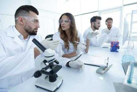 group of young scientists discussing the results of a study