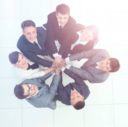 Top view of business people with their hands together in a circle