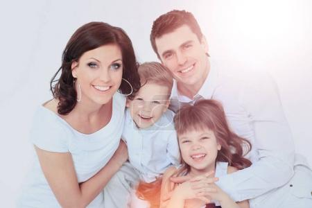 Photo for Beautiful happy family - isolated over a white background - Royalty Free Image