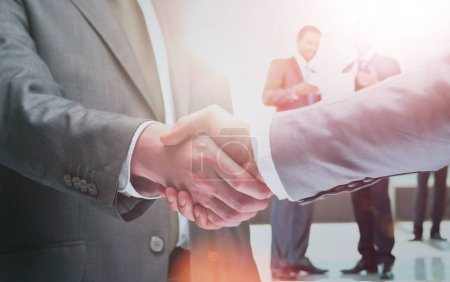 Photo for Closeup of a business handshake in office - Royalty Free Image