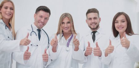 Portrait of happy doctors team showing thumbs up