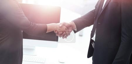 business handshake in modern office