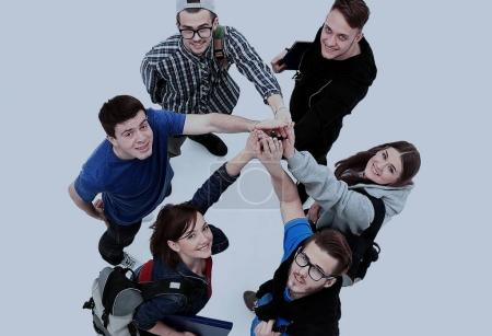 Photo for Top view of young people with their hands together in a circle. - Royalty Free Image