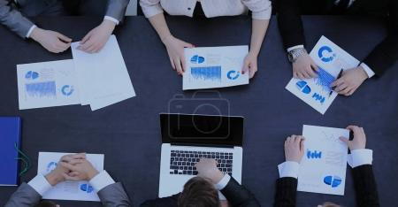 Photo of a young business team working in a modern office. Top v