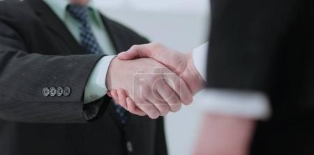 Closeup of handshake as a sign of successful cooperation and int
