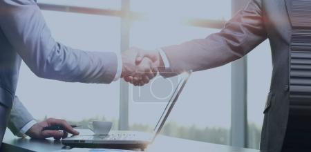 Photo for Business handshake. Morning at the office - Royalty Free Image
