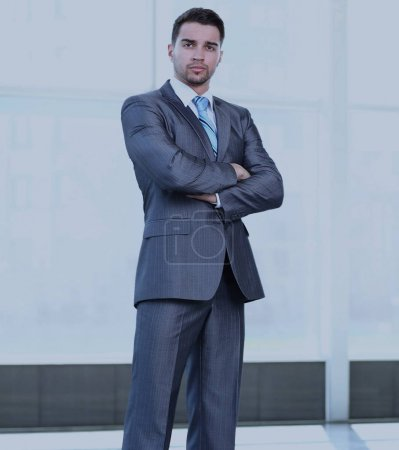 Full length of  successful mature business man with crossed arms