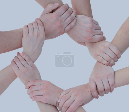 Business people joining hands in a circle in the office