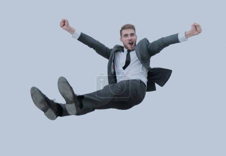 Businessman get thrown into the air by co workers during celebra