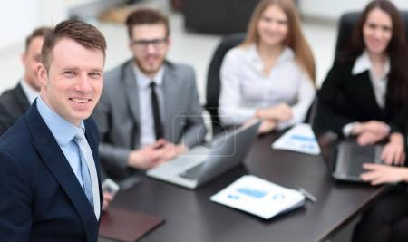 project Manager on the background of business team