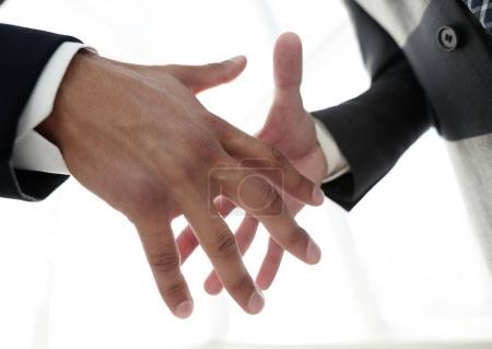 Two  business men going to make handshake