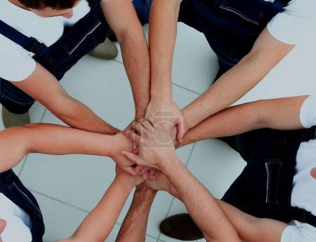 Photo for Team of workers joining hands in circle - Royalty Free Image