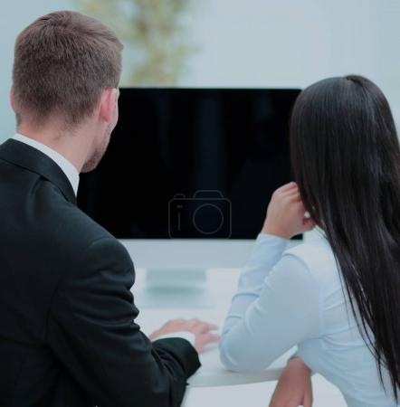 Image of two young business people interacting at meeting in off