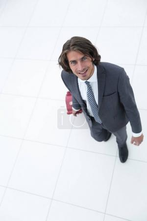 view from the top.businessman with Luggage