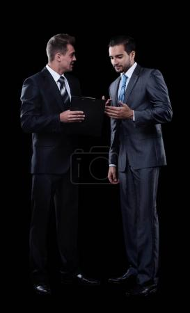 two business partners discussing documents