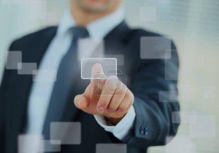business man pressing a touchscreen button.