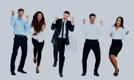 Very happy business people jumping and clenching their fists against white background.