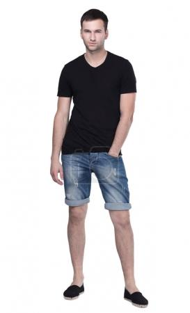 Young handsome guy posing casually isolated on white