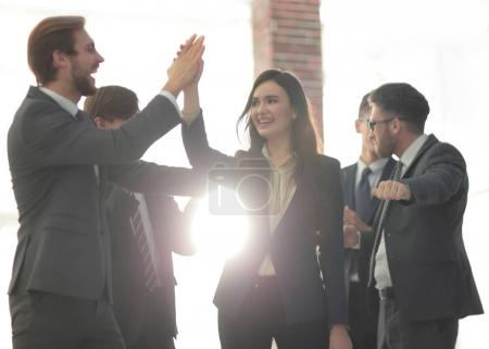 Successful woman leading a business group and looking happy.