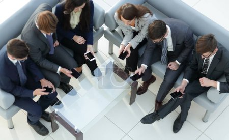 Technology and phone addiction concept. Group of business people