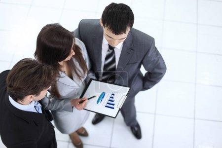 business team discussing a financial chart