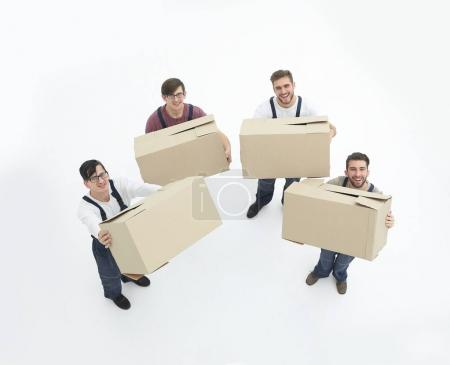 Photo for Delivery men with cardboard boxes on white background. - Royalty Free Image