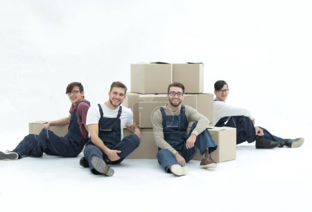 Cheerful workers with stacked boxes isolated on white.