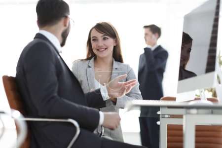 Manager and client talking in the office.