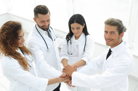 medical team with hands clasped together
