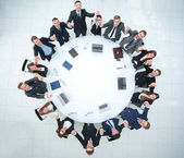 large business team sitting at the round table and raising his hands up