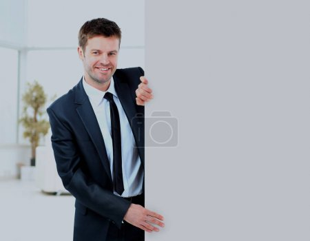 Businessman demonstrates the project to the potential customer and smiling.