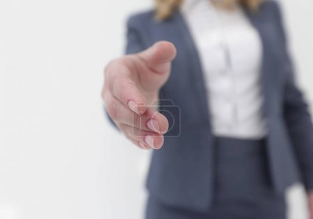 closeup. business woman stretching hand for handshake