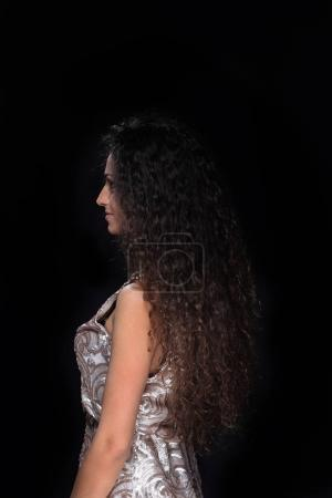 Side view of an attractive woman with curly hair isolated