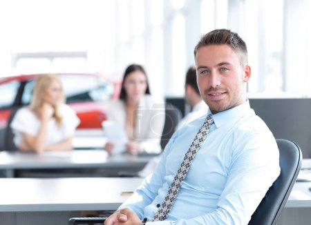 portrait of confident businessman sitting at the Desk