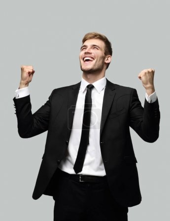 portrait of enthusiastic businessman isolated on a light background.