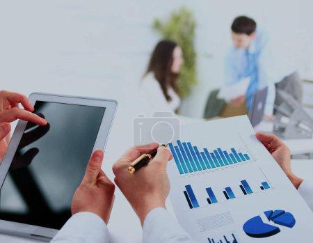 busienssman holding digital tablet in office.