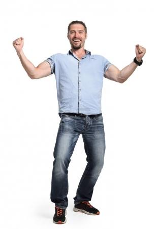 Happy man with hands up, isolated on white